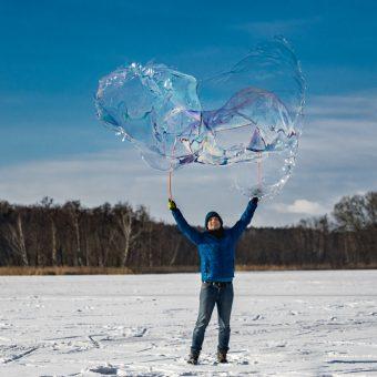 Soap bubbles in a snowy scenery